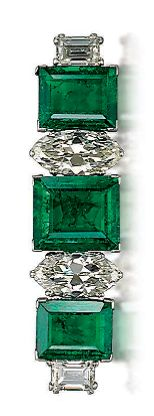 AN ART DECO EMERALD AND DIAMOND BAR BROOCH ~.Set with three rectangular step-cut emeralds, interspersed with two marquise-shaped diamonds to the rectangular-cut diamond terminals, circa 1930s.