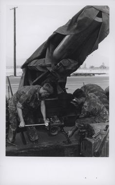 """Marines Install a Firing Jack on a 155mm Howitzer, 1969  """"Fixin' Firepower: Two Leathernecks of the artillery repair section at Maintenance Battalion, Private First Class James E. Jessup, East Wenatchee, Washington and Gary L. McClatchie, Saranac, New York, install a firing jack on a towed 155mm howitzer. The artillery section has the capabilities of repairing all types of weapons at shops at Da Nang or making on-the-spot repairs in the field (official USMC photo by Sergeant Bruce…"""