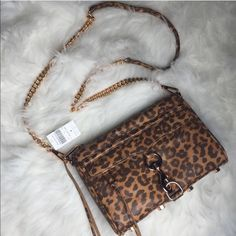 Rebecca Minkoff Leopard Mini Mac Gorgeous Rebecca Minkoff leopard Mini Mac bag. Detachable rose gold chain strap - wear over the shoulder, cross body, or as a clutch. Brand new with tag attached - purchased at Barneys New York for $225. Comes with dustbag. Guaranteed 100% authentic. Photos are my own. Rebecca Minkoff Bags
