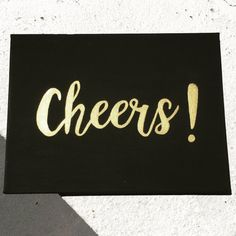 Hand painted Cheers! canvas, 9 x 12 inch. The canvas can be customized allowing you to choose the background color (black or white) and text color (gold, black or white). If you would like a different color message me for more information.  Comes ready to hang on the wall!  Please message me with any questions  Thanks