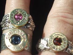 these r ss rings with gemstones faceted by roy and using spent cartiridges  what a beautiful way to recycle.. he can custum make rings and earrings, bracelets and pendants with the bullet cartiridge you want and also with gemstones of your choice.prices r 150.00 for rings and for bracelets ,75.00 pr for earrings and 100.00 for pendant