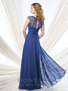 Two-tone chiffon A-line gown with hand-beaded illusion cap sleeves and bateau neckline, crisscross ruched semi-sweetheart bodice, beaded illusion keyhole back, sweep train. Matching shawl included. Sizes: 4 – 20, 16W – 26W Colors: Royal Blue, Bright Purple, Gunmetal