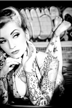 Pin-up tattooed girl :: leopard sleeve, filler tattoos, stars on leg