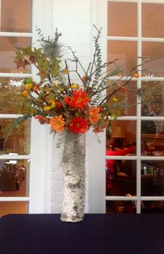 Rustic birch container with lichen branches and Spanish moss for an outdoor October  buffet by Fleur de Vie.