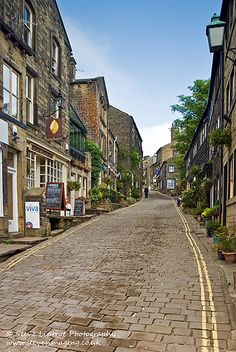 Narrow street of Haworth, West Yorkshire.Nestling just below the West Yorkshire moors,the beautiful village of Haworth is the jewel in the crown of the Worth Valley. Just to the north of Bradford,Haworth is internationally famous for its connections with the Brontë family, and the three sisters in particular. The majority of their famous works were written during the time they lived at the village Parsonage,whilst their father was parson at the nearby church of St. Michael and all the…