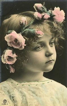 Beautiful little girl with crown of roses