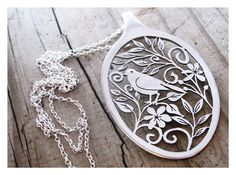 cut out folk art spoon pendant by #HelenSilverSmit https://www.etsy.com/listing/198745296/folk-art-statement-ooak-spoon-necklace. I would charge a kazillion dollars for this one.