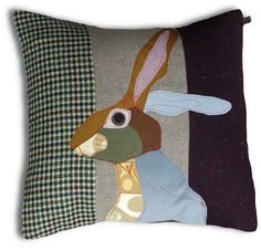Beautiful Rabbit with lovely colour and fabric combinations. In the middle a panel of Lithuanian linen. With mole grey cotton/linen backing. Comes with duck feather filled pad. 50 x 50 cm.