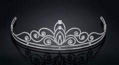 A modern Tolkowsky Diamond Tiara with 400 individually set diamonds totaling over 5 carats.