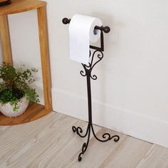 Best Toilet Paper Holder Stand — Equutrails Homes Toilet Paper Holder Stand, Best Toilet Paper, Bookshelves In Living Room, Wrought Iron Decor, Iron Furniture, Iron Art, Metal Wall Decor, Bathroom Styling, Lamp Design