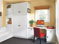 The built-in storage cabinets and desk in this mudroom were hand-built by the owner. The beadboard fronts match the cabinets in the adjacent kitchen