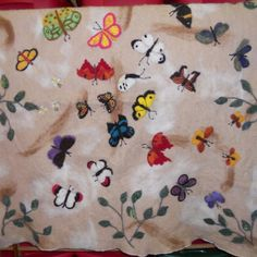 Hand needle felted art on a felt sheet made at East Valley Alpacas / The Fiber Factory. 4' x 4' sheet with finished edges.