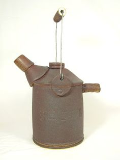 Handmade pottery oil can by Jan Wallace