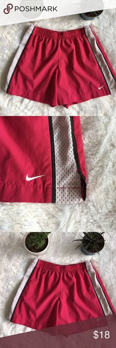 Pink NIKE Athletic Shorts Lightweight athletic NIKE shorts. Women's size Small, stretchy band. No stains or holes! Nike Shorts