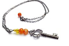 Check out this item in my Etsy shop https://www.etsy.com/listing/218906763/skeleton-key-necklace-orange-jade