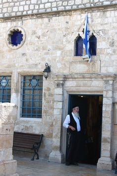 """A rabbi stands outside a synagogue in Tsfat. From photo essay """"Land of Milk and Honey,"""" an exploration of food and culture around Israel. Jewish Synagogue, Jewish Temple, Israel Travel, Israel Trip, Messianic Judaism, Visit Israel, Jewish Museum, Shabbat Shalom, Milk And Honey"""