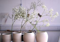 Raw clay vases + gypsophilia