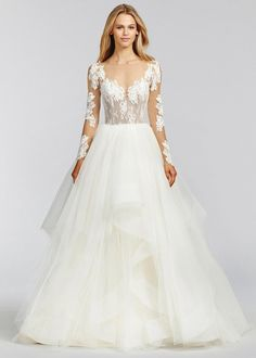 Inspired by the Haley Paige Pippa. Ivory lace and tulle bridal ball gown, illusion bateau neckline with sweetheart lining, low open back with crisscross strap detail, cascading tulle skirt with horseh