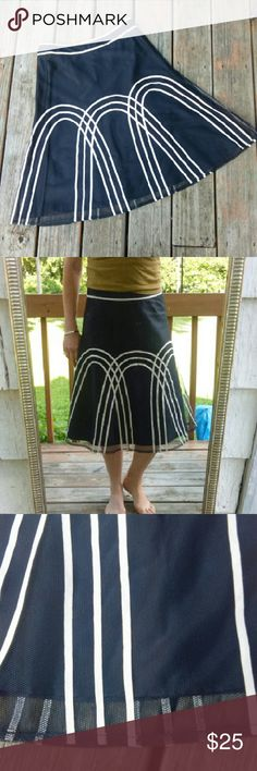 """Ann Taylor LOFT Midi Skirt This skirt is STUNNING!!! Navy blue & white details, 100% polyester shell with 100% acetate lining, midi skirt by Ann Taylor LOFT with a hidden side zipper and hook eye closure. Size 6P, but can also work for non-petites as well..see measurements. Waist is 14.5"""" wide and total length of lining is 23 3/4"""" long and total shell length is 25"""". Excellent gently used condition! LOFT Skirts"""