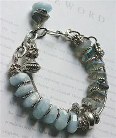 Aquamarine ab bangle quartz charm bracelet, $69.99, by Mollie Carey