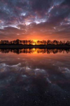 """sunrise reflections by Denny Bitte """