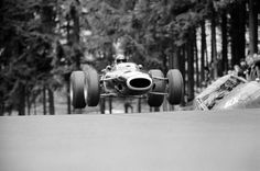 1966, Nuerburg, Germany — Jackie Stewart aviates his BRM 261 past the remains of a crashed touring-car on the Nurburgring track at Brunnchen in the German Grand Prix. — Image by © Schlegelmilch/Corbis