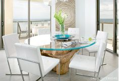 """Reflecting the colors, climate, and culture of this vibrant city, Miami design is a mosaic of diverse inspiration. Bring the look to your dining room with layers of textured neutrals accented by bursts of bright color for a breezy, open space that sizzles. Ultramodern silhouettes complete your Magic City entertaining space with a fun flair that will have your guests saying """"bienvenidos a ..."""