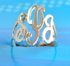 initial monogram ring hand made by US hands ,SSR2 , sterling silver ring.. $59.00, via Etsy.
