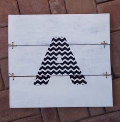 A personal favorite from my Etsy shop https://www.etsy.com/listing/234387457/rustic-chevron-monogram-sign-chevron