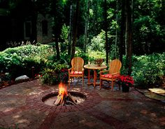 I like the formal style of the patio with the informal vibe of the fire pit & seating.