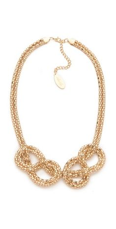 Gold knot necklace.