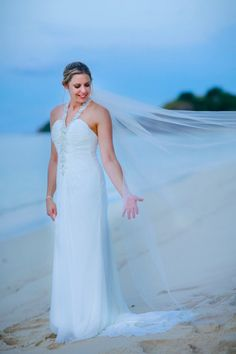 Sheath summer beach wedding dress is super comfortable to wear. Chiffon is ruched toward an extraordinarily beaded, halter neckline. The high-glamor encrusted halter straps transform into a charming back. Ivory color. Very flattering inbuilt corset as it pulls in and makes a waist.