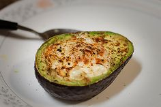 Baked avocado with eggs Preheat the oven to 350° F. Halve an avocado, remove the pit, and scoop out some of the green flesh. Break an egg into a bowl and carefully place the yolk in an avocado half, followed by the white. Repeat with the other half. Season and add toppings before baking for 15 to 20 minutes.