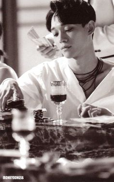 just remember chen chen scene on lotto mv. being pointed with gun by the agents and he still manages his leg on the table while holding a glass of wine, why so serious? #chen