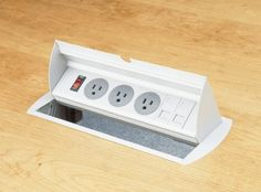 The customizable PDH neatly conceals power points below the work surface unit needed in which case the unit is simply flipped up. Plug tops can stay connected to the unit it the down position. Perfect for Boardrooms or location with limited space.