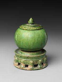 Jar with Cover and Base Period: Tang dynasty (618–907) Date: early 8th century Culture: China Medium: Earthenware with green glaze Dimensions: H. 3 1/8 in. (7.9 cm)