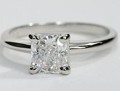 Simple and elegant, this solitaire engagement ring in platinum allows your diamond to take center stage. The four prong setting lets more of your center diamonds brilliance to shine through to please the eye. You can choose a round, princess, cushion, Asscher, emerald, oval, or radiant cut diamond.