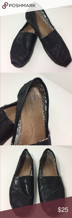 Toms flats Black shimmery toms flats. In great condition. Not much wear on the bottom. Only wear I see is the toes. Not very noticeable. The inside says W7. TOMS Shoes Flats & Loafers