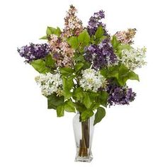 """Silk lilac arrangement in a clear glass vase.    Product: Faux floral arrangement  Construction Material: Silk and glass   Color: Pink, purple and white Features:     Delicate, colorful petals and green leaves   No watering needed    Dimensions: 24"""" H x 18"""" Diameter"""