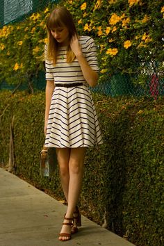 Reading Between The Lines- Emma Approved: Harriet_ Navy and white striped skater dress, floral bag, cognac strappy heeled sandals, and teapot necklace.