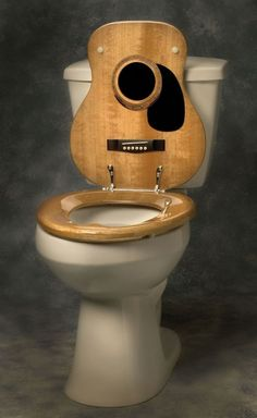 20 Offbeat Gifts for the Music Fan That Has Everything If you've ever been told that your music belongs in the toilet, why not shove that back in your friends' and family's fa. Guitar Room, Guitar Art, Guitar Crafts, Guitar Songs, Music Furniture, Diy Furniture, Objet Deco Design, Diy Recycling, Guitar Stand