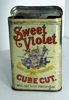 Sweet Violet Cube Cut Tin features lovely lettering and image of a violet bouquet.  Manufacturer: Globe Tobacco Co., Detroit, Michigan
