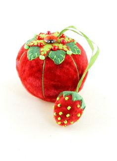 2014 OOAK Janie Comito~ Velvet Tomato Pin Cushion & Strawberry ~Ladybug Button~ Anticipating that spring will arrive sooner than later, Janie has created a pin cushion with hopes for warmer days. A traditional tomato, hand sewn from red crushed velvet with green embroidered ultra suede leaf appliques decorated with green glass beads, red satin head pins & a perky little vintage ladybug button. A matching glass beaded strawberry emery is attached by a silk ribbon.