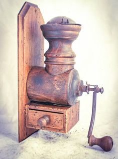 WALL MOUNTED Coffee Grinder Mill UNMARKED PROBABLY Italian and made c1940 Max. Measurements: Wood: H30 cm x W11 cm Coffee grinder: H27 cm x W11.5 cm x D20 cm Wood and Iron Good condition and grinding smoothly with very nice fine coffee powder, see photos sold as is. THE