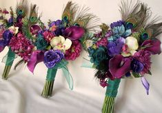 Teal Peacock Bridal Bouquet and Bridesmaid Flowers.