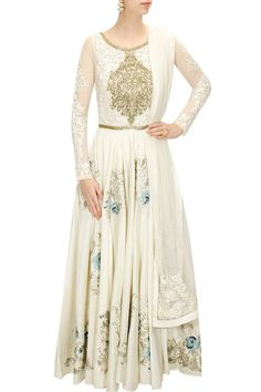 This anarkali is in ivory colour with floral embroidery with contrast blue and navy embroidery on pleats. It has white and gold floral applique work embellished
