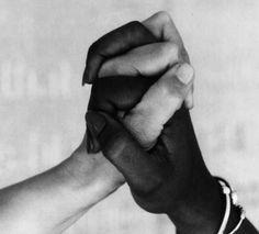Black, white hand holding