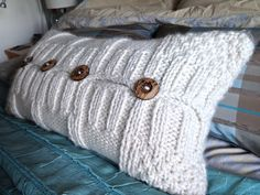 Knitted cushion with buttons