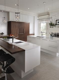 White units with white work top. Would like with dark wood floor and dark breakfast bar as shown.