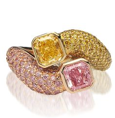 Radiant-cut pink and yellow diamonds set in yellow gold with pave-set yellow and pink diamonds down the sides.